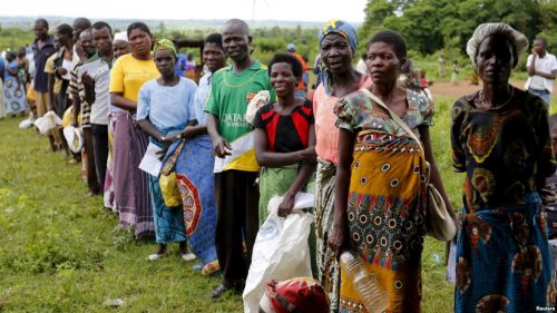 Malawians queue for food aid distributed by the United Nations World Food Program (WFP)
