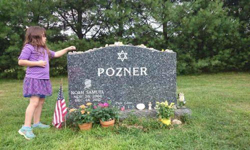 Noah Ponzer's sister, at his grave