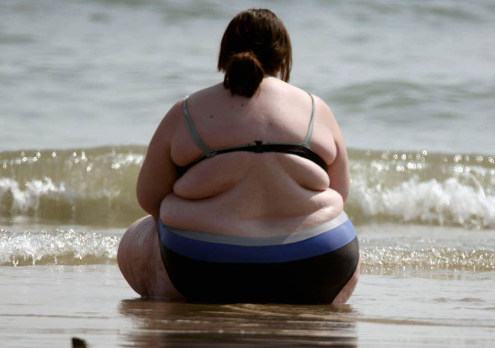 Obese Woman At Beach